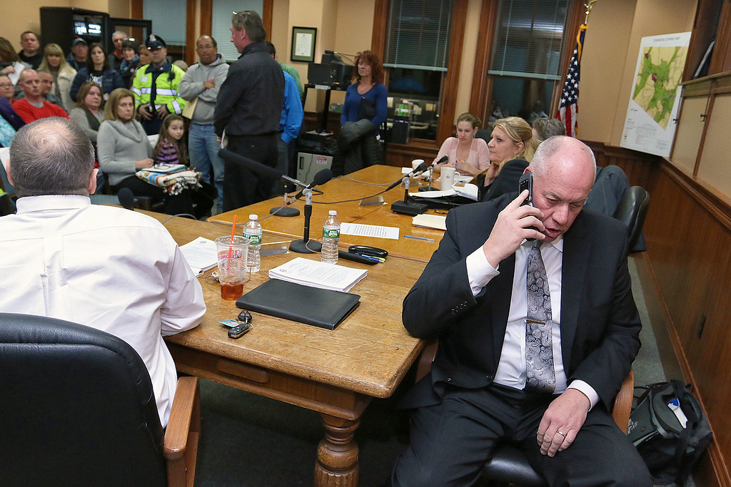 . Residents filled the Townsend Selectmen\'s chambers during their meeting set for 6 p.m. on Tuesday February 14, 2017 and caused them to chancel the meeting. Selectman Gordon Clark uses his cell phone to try and reach the Townsend Police while in the chambers with the residents. SENTINEL & ENTERPRISE/JOHN LOVE
