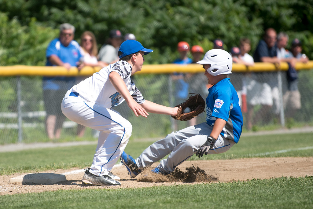 . Lunenburg Knights Luke Augusta (left) reaches for the tag as Leominster base runner Zack Casey slides safe into 3rd during Sunday\'s Little League game on July 9, 2017 in Lunenburg.  SENTINEL & ENTERPRISE JEFF PORTER