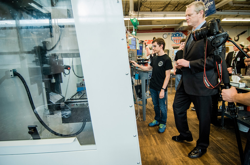 . Luke Aveyard shows off equipment recently purchased with a Skills Capital Grant to Gov. Charlie Baker as he toured the Leominster Center For Technical Education Innovation on Wednesday, May 31, 2017. SENTINEL & ENTERPRISE / Ashley Green