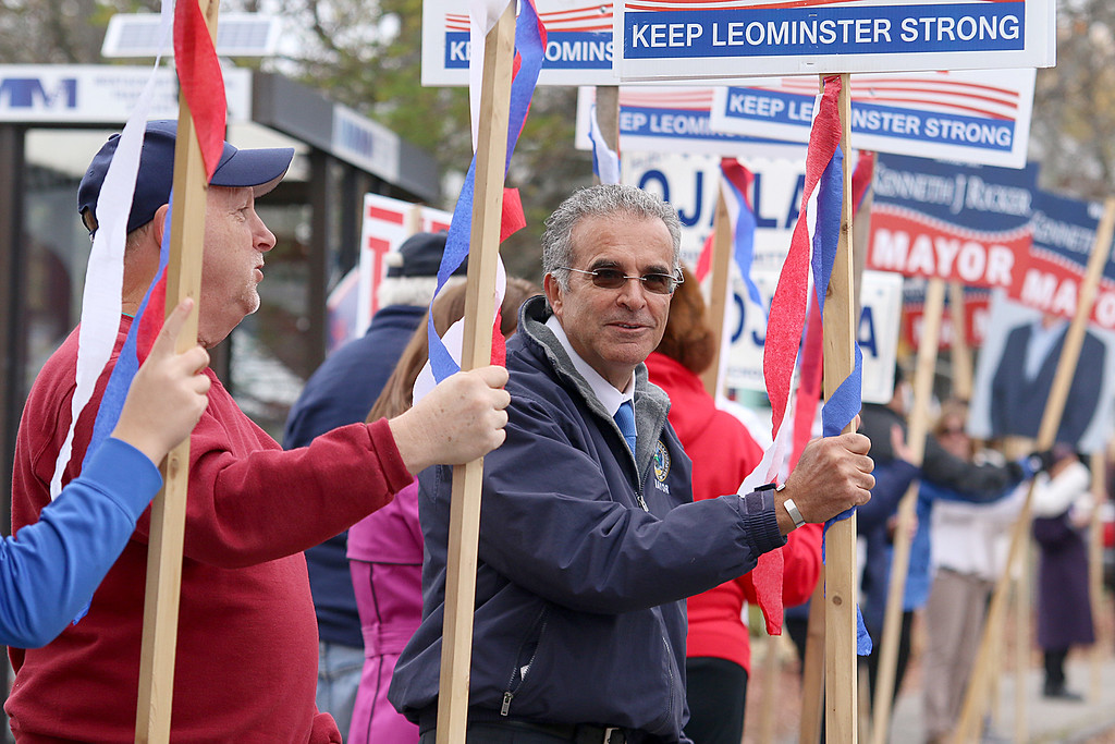 . Incumbent Mayor Dean Mazzarella holds one of his signs outside the polls at the Veterans\' Center in Leominster on Tuesday afternoon. SENTIENL & ENTERPRISE/JOHN LOVE