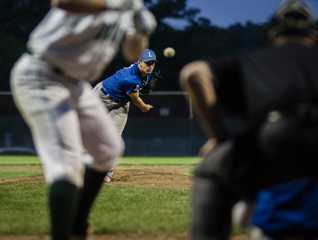 . Leominster\'s Lucas Amico delivers a pitch during the Central Mass. D1 semfinal game against Wachusett on Wednesday, June 7, 2017. SENTINEL & ENTERPRISE / Ashley Green