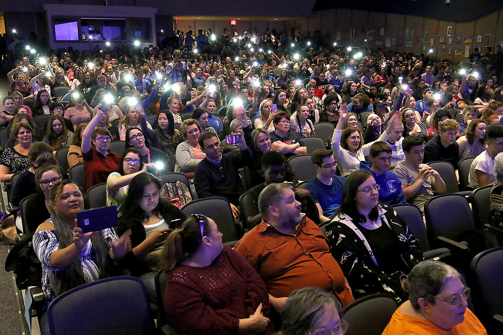 . Leominster High School students wave their phones in the air with the light on as they cheer on the Life Skill class during the eighth annual talent show on Thursday April 13, 2017. Sentinel & ENTERPRISE/JOHN LOVE