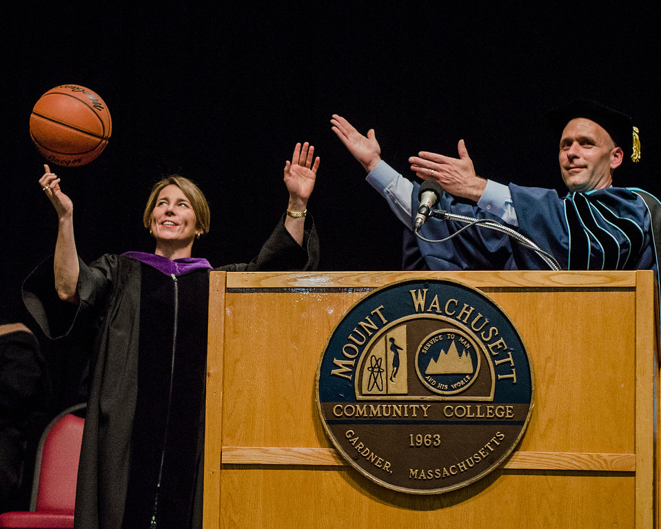 . Attorney General and Commencement Speaker Maura Healey spins a basketball at the request of President James Vander Hooven during the 52nd Commencement Ceremony at Mount Wachusett Community College on Wednesday, May 17, 2017. SENTINEL & ENTERPRISE / Ashley Green