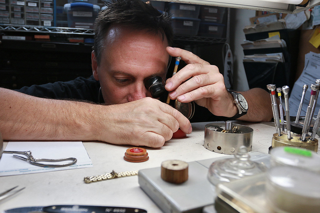 . John Lynch shows how he fixes a pocket watch at his shop John\'s Watch and Jewelry on Thursday, August 10, 2017. SENTINEL & ENTERPRISE/JOHN LOVE