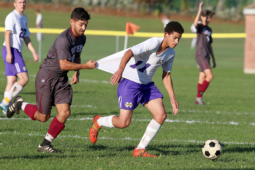 . Ayer Shirley Regional High School boys soccer played Montachusett Regional Vocational Technical School on Tuesday in Fitchburg, October 31, 2017. ASRHS\'s Leonardo Rosales uses some grab tactics to try and stop Monty Tech\'s Captain Charlie Kelley. SENTINEL & ENTERPRISE/JOHN LOVE