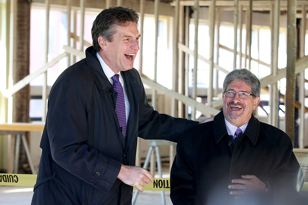. Fitchburg State University showed off their work on the Theater Block on Main Street in Fitchburg during their phase one of the project Wednesday morning, January 31, 2018.  Secretarty of Housing and Economic Development for the Commonwealth of MA Jay Ash and Fitrchvurg MAyor Stephen have a good laugh as Ash addresses the crowd that came to see FSU\'s phase one of the Theater Block. SENTINEL & ENTERPRISE/JOHN LOVE