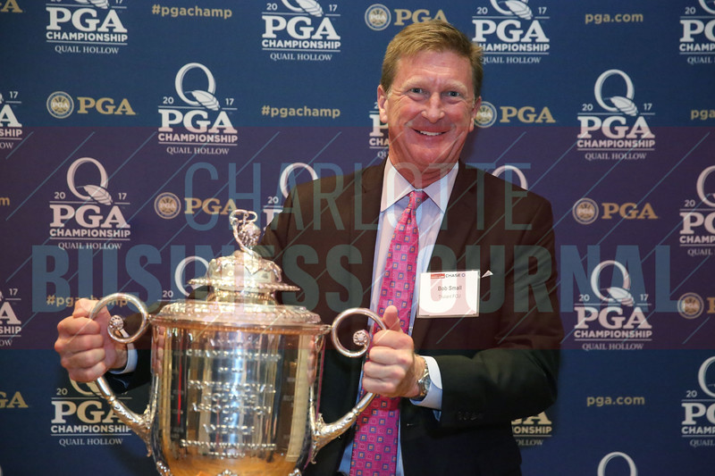 Bob Small of Truliant FCU poses with the PGA Championship Wanamaker Trophy.
