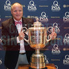An attendee poses with the PGA Championship Wanamaker Trophy.