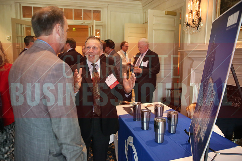 Les Sacani of Chase talks at the Spectrum table at CBJ's PGA Championship Event.