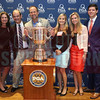 Spectrum Properties team members pose with the PGA Championship Wanamaker Trophy.