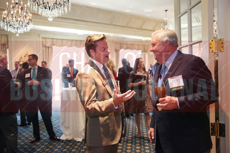 Kevin Pitts, CBJ Publisher, and Johnny Harris, CEO of Lincoln Harris, talk before CBJ's PGA Championship Event on Wednesday.