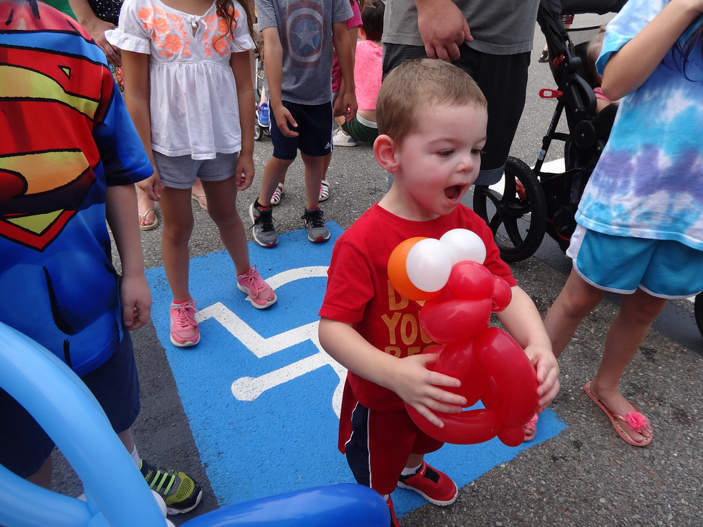 . Andy Isabelle, 2, of Billerica, was delighted with his Ernie balloon. Photo by Mary Leach