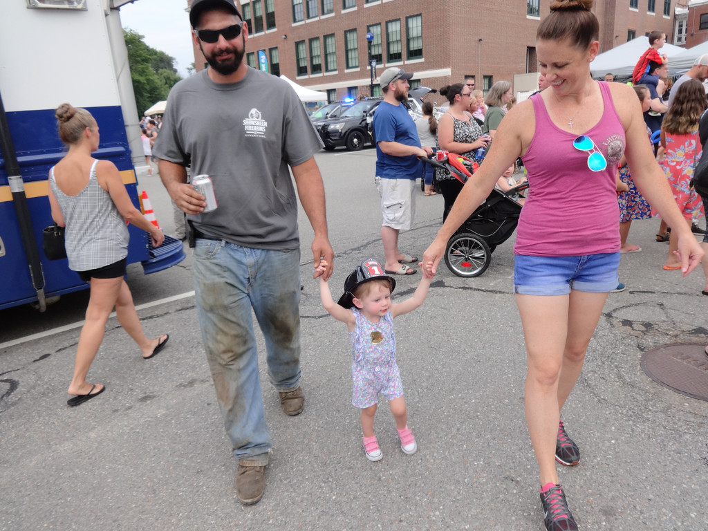 . Ava Cedrone, age 1-1/2, held hands with her parents Nick and Emily. The Billerica family seemed to enjoy National Night Out. Photo by Mary Leach
