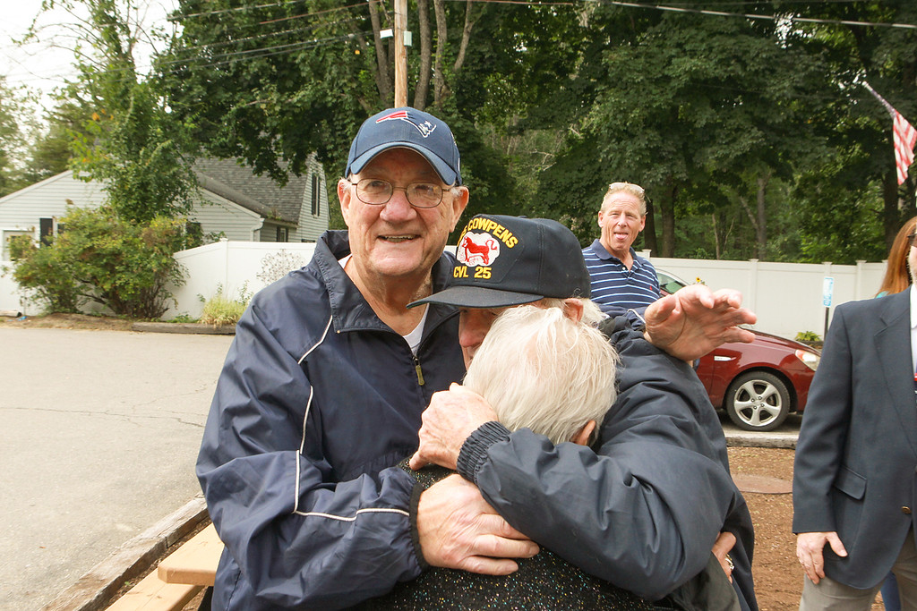 . Daly shares a hug with John Sacco and his wife Marie at the party. Sacco was Daly�s partner during Daly�s roughly 30-year career with Boston police. SUN/SCOTT LAPRADE