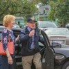 Surprise covers World War II veteran Arthur Daly's face as he emerges from a Townsend police cruiser at a surprise (early) 97th birthday party at the Townsend VFW Post 6538 on Sunday. SUN/SCOTT LAPRADE