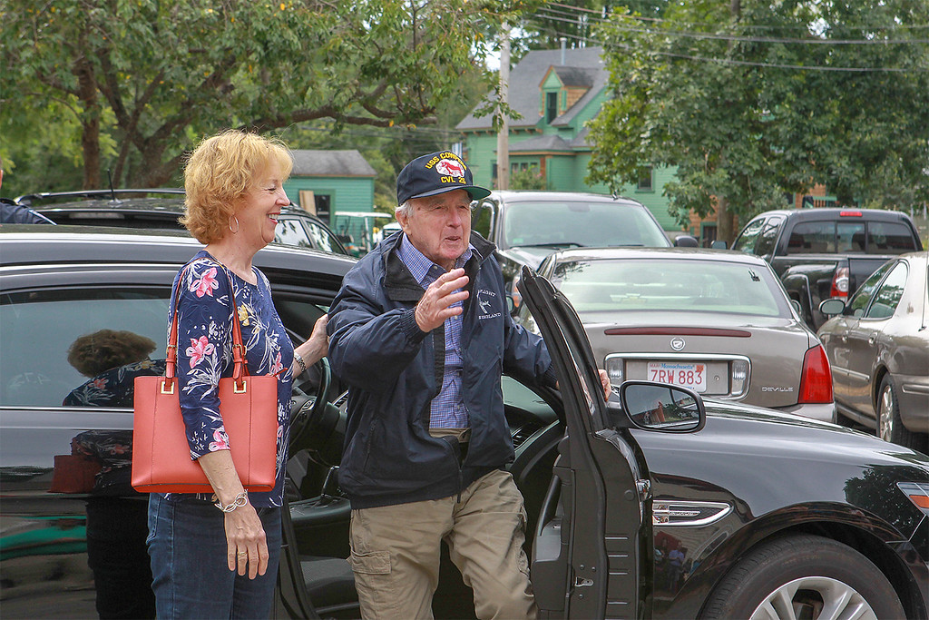 . Surprise covers World War II veteran Arthur Daly�s face as he emerges from a Townsend police cruiser at a surprise (early) 97th birthday party at the Townsend VFW Post 6538 on Sunday. SUN/SCOTT LAPRADE