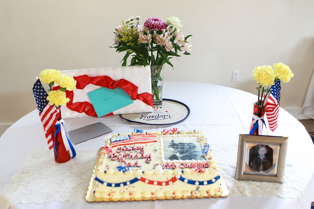 . A cake, present and photograph of Daly as a boy decorate a table. SUN/SCOTT LAPRADE