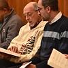 Fr. Bob and Fr. Rafael share a hymnal