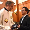 Frater Henry gives Fr. Carlos Luis a gift