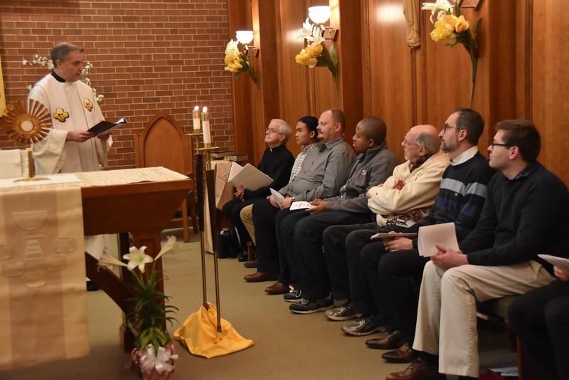 Fr. Carlos Luis speaks to the SHM community