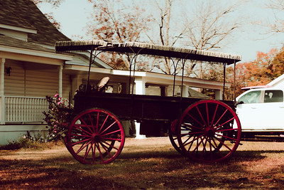 A antique carriage on a front lawn in South Carolina,  USA