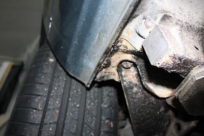 Left rear suspension mounting area rusty