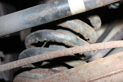Left rear spring rusty