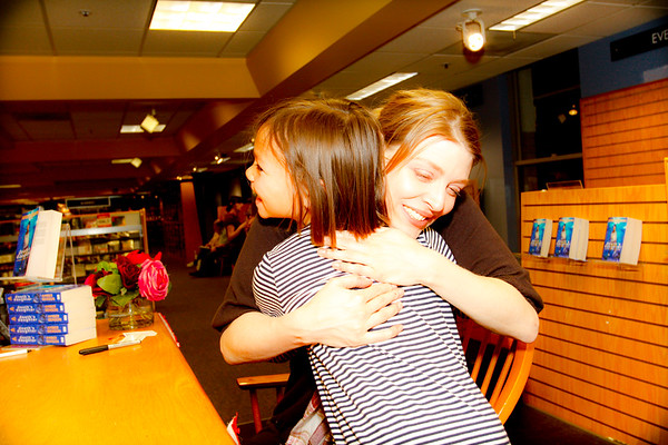 Told ya She brings real World hugs to