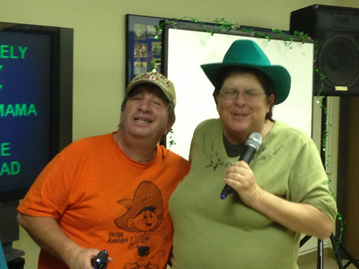 Marty and Carolyn singing karaoke