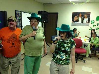 Marty, Carolyn and Dana singing Karaoke
