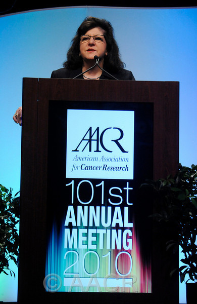 Washington, D.C. - AACR 101st Annual Meeting 2010: AACR Chief Executive Officer Margaret Foti, Ph.D., M.D. (h.c.)., speaks during the opening ceremonies at the American Association for Cancer Research Annual Meeting here today, Sunday, April 18, 2010. More than 17,000  physicians, researchers, healthcare professionals, cancer survivors and patient advocates from 60 countries are attending the meeting which is being held at the Walter E Washington Convention Center. The meeting covers the breadth of cancer science from basic through clinical and epidemiological research. Date: Sunday, April 18, 2010 Photo by © AACR/Phil McCarten 2010 Technical Questions: todd@toddbuchanan.com; Phone: 612-226-5154. Keywords: Opening Ceremonies,Margaret Foti, M.D., Ph.D. Session: 324