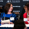 Monica Barlow, left, smiles with fellow cancer survivor Melanie Nix after speaking about her battle with lung cancer during the launch of the American Association for Cancer Research (AACR) progress report 2012 held at the National Press Club in Washington, DC on Sept. 12, 2012. (Photo by Alan Lessig for AACR)