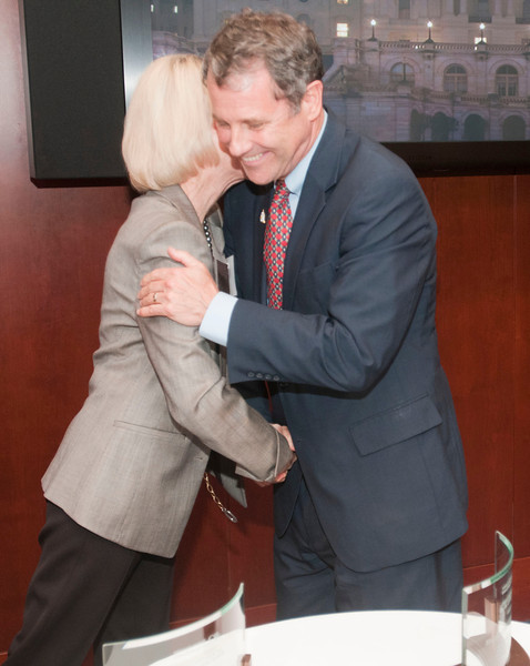 Dr. Anna Barker, left, hugs  Sen. Sherrod Brown while presenting him the AACR Distinguished Public Service award during a Congressional Reception celebrating progress in cancer research, held at the U.S. Capitol Visitors Center on Sept. 12, 2012. Earlier in the day, the American Association for Cancer Research (AACR) released it's Progress Report 2012 (Photo by Alan Lessig for AACR)