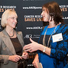 Dr. Anna Barker, left, from AACR, speaks with cancer survivor Monica Barlow, right, after the launch of the American Association for Cancer Research (AACR) progress report 2012 held at the National Press Club in Washington, DC on Sept. 12, 2012. (Photo by Alan Lessig for AACR)