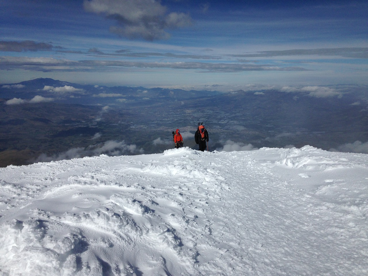 Ecuadorian IFMGA guide Fredy Tipan nearing the summit of Cayambe with his team.