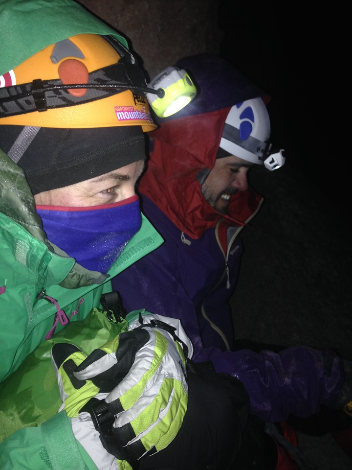 Climbers Hallie and Andrew hunker down in the early morning hours while ascending Chimborazo.
