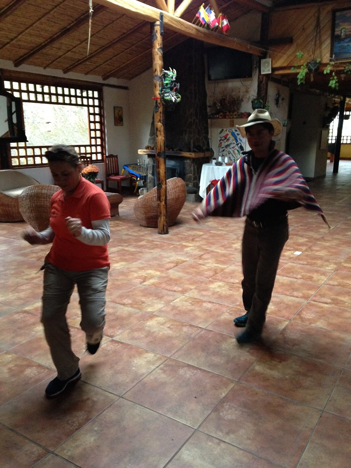 The proprietor of Hacienda Guaytara and Guide Romel Sandoval dancing.