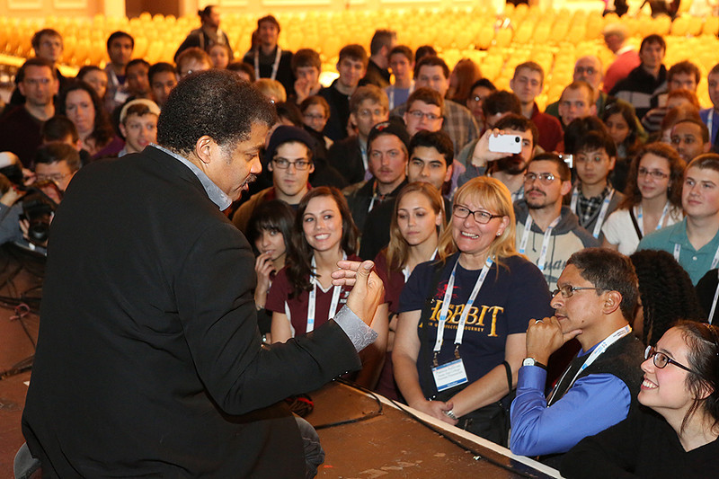 "On Monday evening Neil deGrasse Tyson (American Museum of Natural History) regaled a packed lecture hall with ""Tales from the Twitterverse, and Other Media Excursions."" Tyson's celebrity status was evident when a crowd of admirers swarmed the stage after the presentation to spend a few more minutes talking with him about astronomy and public outreach.  AAS photo © 2014 Joson Images."