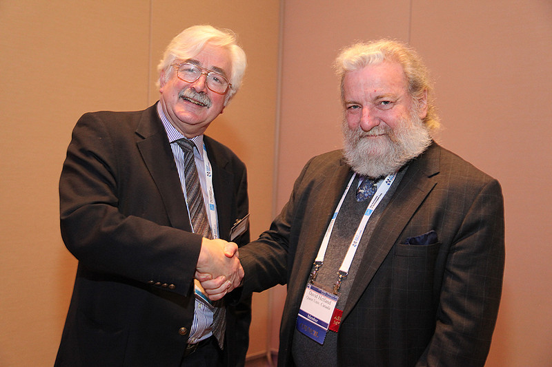 On Wednesday afternoon the Royal Astronomical Society hosted a reception for AAS-meeting attendees who also happen to be RAS members. Here RAS President David J. Southwood shakes hands with AAS President David J. Helfand. AAS photo © 2014 Joson Images.