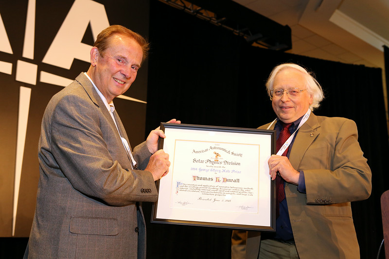 "Thomas L. Duvall (NASA Goddard Space Flight Center), at left, received the George Ellery Hale Prize from Solar Physics Division chair Leon Golub (Smithsonian Astrophysical Observatory). Duvall's prize lecture was entitled ""Waves Excited by Noise: Applications to Helioseismology and Beyond."" AAS photo © 2014 Joson Images."