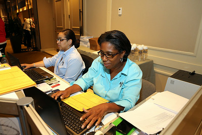 Staff members Crystal Tinch (left) and Tracy Beale ran the busy AAS registration desk during the Boston meeting. AAS photo © 2014 Joson Images.