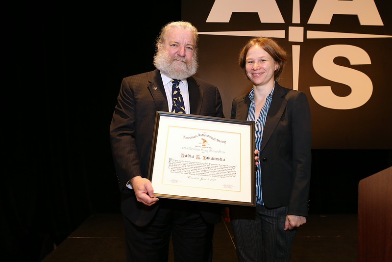"Nadia L. Zakamska (Johns Hopkins University) is the 2014 recipient of the Newton Lacy Pierce Prize for observational research by a young astronomer. After being introduced by AAS President David Helfand (Quest University Canada), Zakamska delivered her prize lecture, ""Quasars and Their Effect on Galaxy Evolution."" AAS photo © 2014 Joson Images."