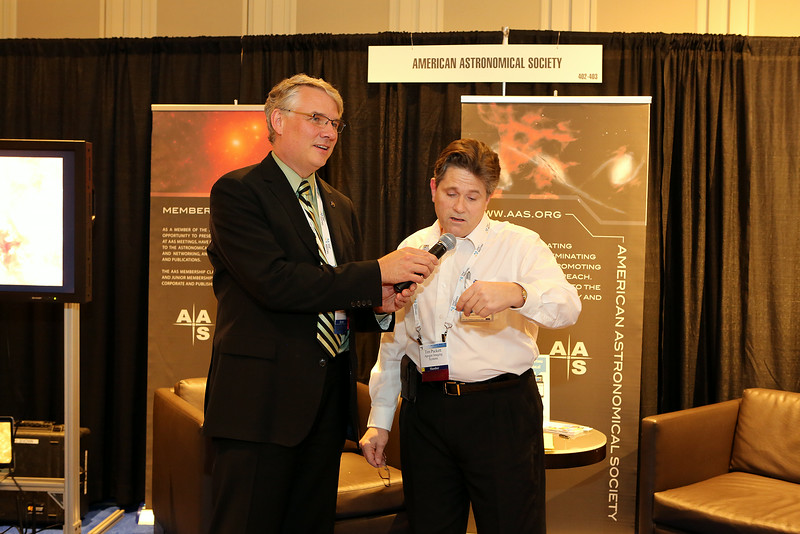 The AAS closing reception on Wednesday evening provided an opportunity for some lucky astronomers to win raffle prizes from some of our exhibitors and sponsors, including a CCD camera from Apogee Imaging Systems. Here AAS Executive Officer Kevin Marvel holds the microphone while Apogee's Tim Puckett reads the number of the CCD-winning raffle ticket. AAS photo © 2014 Joson Images.