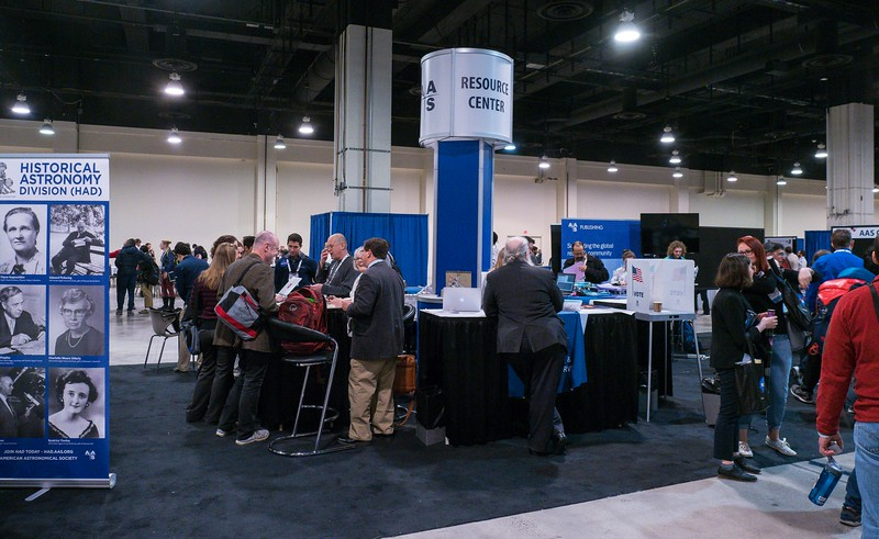 Attendees in the AAS Booth - Tuesday Exhibit Halls