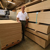 President Andy Crosby of ABCrosby & Company, Inc. stands next to some particle board that he gets from Canada. SENTINEL & ENTERPRISE/JOHN LOVE