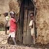 Masai Children by Their Hut