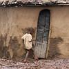 Masai Child Stepping Toward the Hut Door