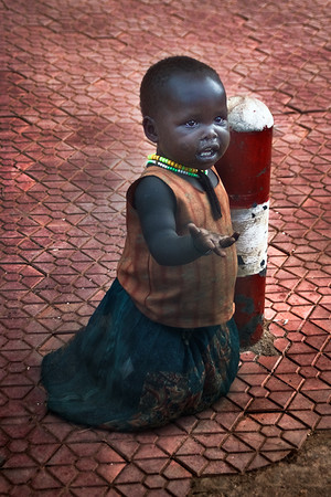 A baby/toddler begging to survive on the streets of Kampala, Uganda, Africa.