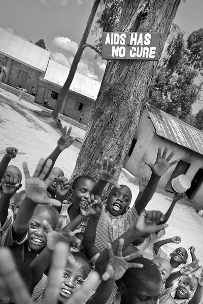 As I walked around the school in Masaka I found this sign, and the moment I was taking the picture Aids Orphans jumped into the scene.
