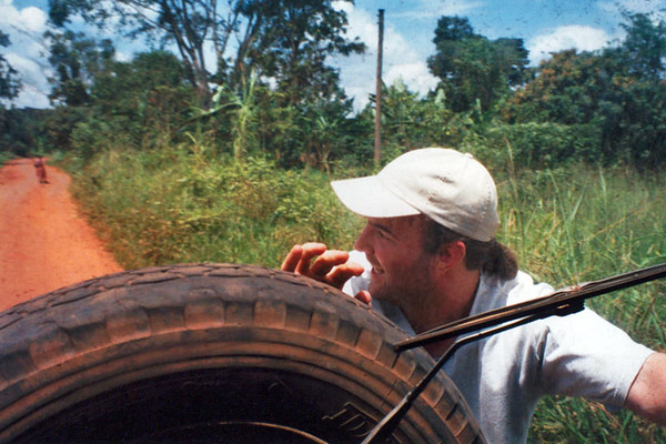 The routine of pushing the vehicle out of mud holes in remote Uganda. Yes, with a smile on my face! :)
